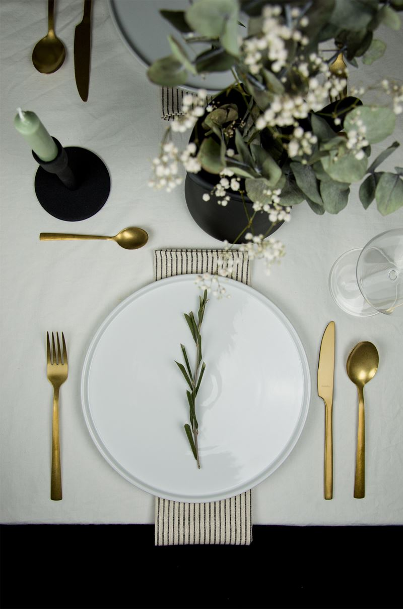 The gold cutlery has a stonewashed finish