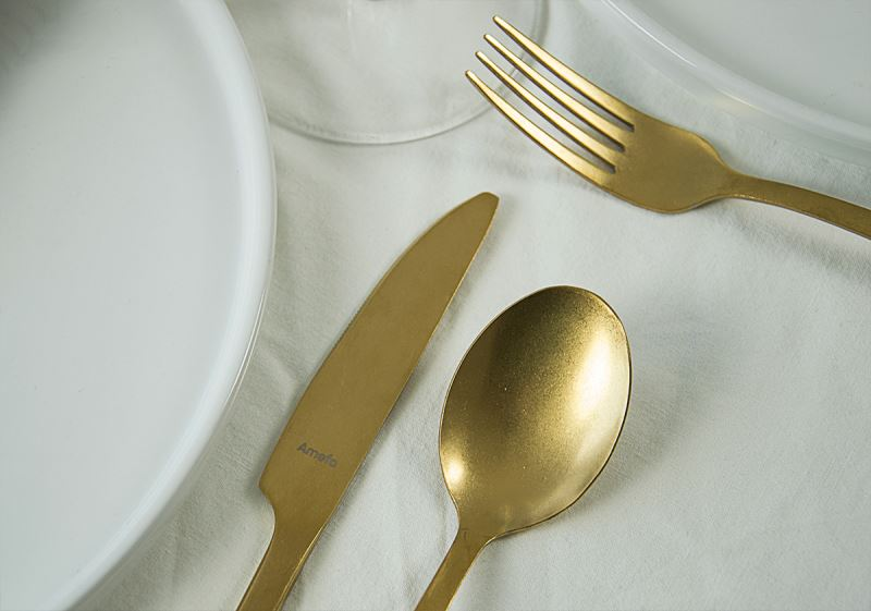 The stonewashed look on the flatware gives the pieces the old look