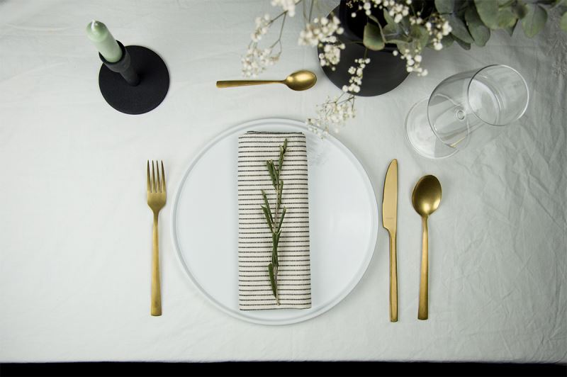 The flatware has a gold coating, which is very on-trend